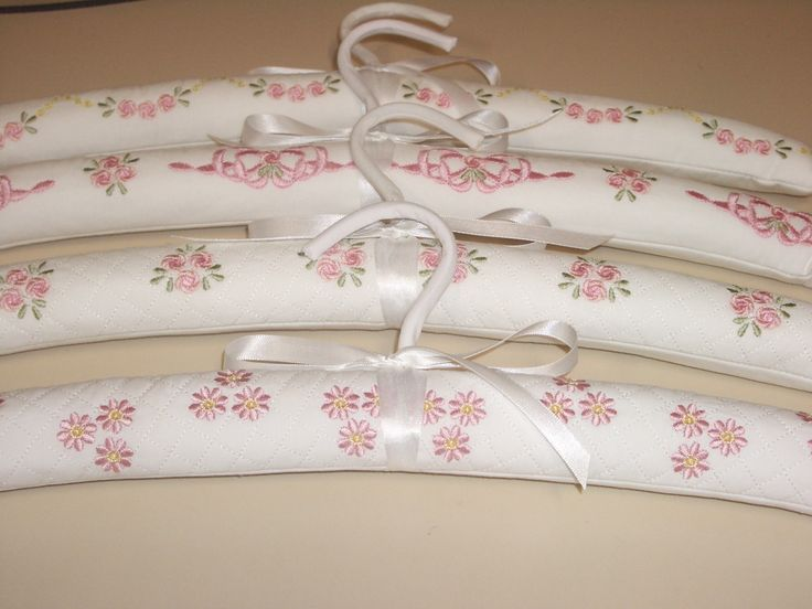 Embroidered covered hangers using cotton fabric, and covered onto a padded wooden hanger. I love making these also.