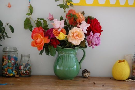 Jug of bright garden grown roses
