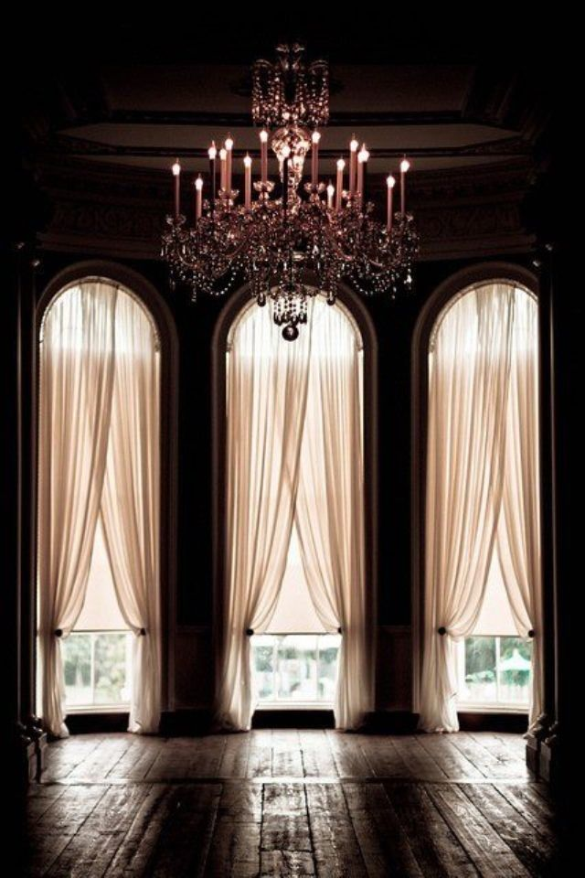 chandelier + long curtains home interior design