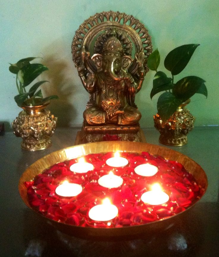 Beauty of lamps in rose petals and Ganesh