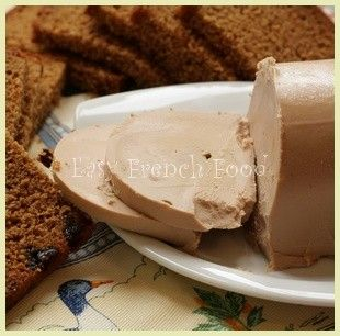 Foie Gras served with spice bread. Served as L'aperitif (appetizer) Made from fatty liver of a goose or duck that was fed with rich grains