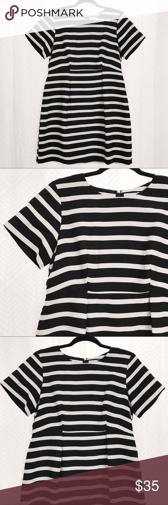 H&M Striped Dress H&M Black and Ivory Striped Dress. Size 12 (runs small, fits like a 10). A-line cut, fabric keeps its shape, visible gold back zipper. Gently used, no damage. Great for fall/winter. Add some tights and boots - you're set for a night out! H&M Dresses Mini