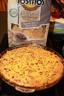 Hello, football season! White Trash Dip  1 can chili (15 oz) 2 packages cream cheese (8 oz ea), softened 2 cups cheddar cheese, shredded 1 lb. bacon 4 green onions, chopped 1 tsp red pepper flakes Heat oven to 350 degrees. Cook bacon. Crumble. Mix together chili, cream cheese, cheddar cheese, bacon, and green onions in a large bowl. Spread mixture into a pie pan. Cook for 20 minutes in a 350 degree oven. Sprinkle with red pepper flakes. Serve with chips.