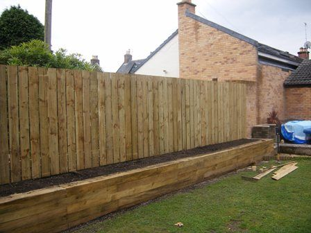 Image detail for -Install Palisade Fence. Raised flower bed with Sleeper Retaining Wall ...