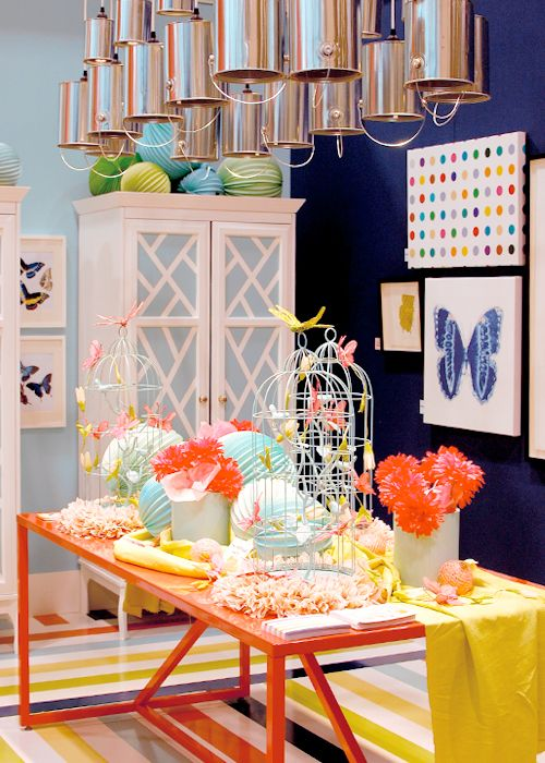 """Bright striped floor, orange table, colorful art work, blue walls and all the party decor makes this room shout """"happy""""!  But the""""scene stealer"""" is that paint bucket chandelier! Love the freedom & flow of creativity in this room!  TV"""