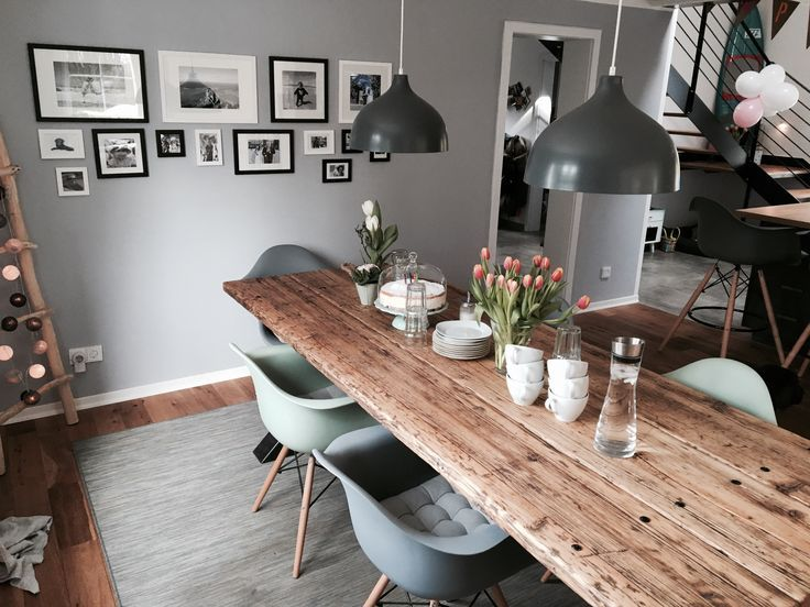 Dining room with massive timber table of timber love in industrial design. Massivh