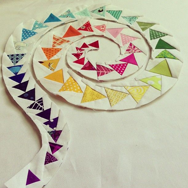 "My latest finish is my spiral of geese mini quilt for Fab Little Quilt Swap.  It measures 20""x 20"" and consists of 50 paper-pieced flying geese on a reverse appliqued background. I quilted it on my..."