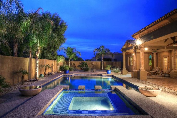 Mediterranean Swimming Pool with Gate, exterior stone floors, Pool with hot tub, Fence