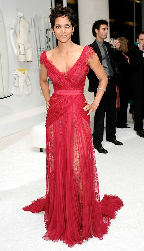 Halle Berry dressed in a red lace and silk chiffon Elie Saab gown.