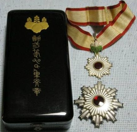 Order of the Rising Sun (2nd Class Medal and Breast Star). This Japanese award was instituted in 1875 as the first national decoration with 8 classes, changed to 6 in 2003. Awarded for a great variaty of civil reasons; it was also a military award before World War II. A famous recipient of this order (and class) was Jules Brunet; a French army officer who served as advisor to the Shogunate rebels and Ezo Republic commander during the Boshin War.