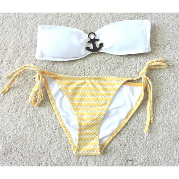 Super cute anchor bikini Sz small **PLEASE COMPARE YOUR MEASUREMENTS TO THE ONES NOTED..DONT JUST GO BY THE SIZE TAG.  A SMALL DOESN'T ALWAYS FIT LIKE A SMALL.  I HAND MEASURE.  Super cute Anchor bikini  very nice quality  size small bust 30-32 (probably best for A or B Cup) removable pads  hips 32-34 string tie bottoms  golden yellow with metallic matte gold print  anchor accent in middle  hooks in back  removable neck strap RETAIL BRAND NEW BUT NO TAGS  brand new  hygiene protector in…