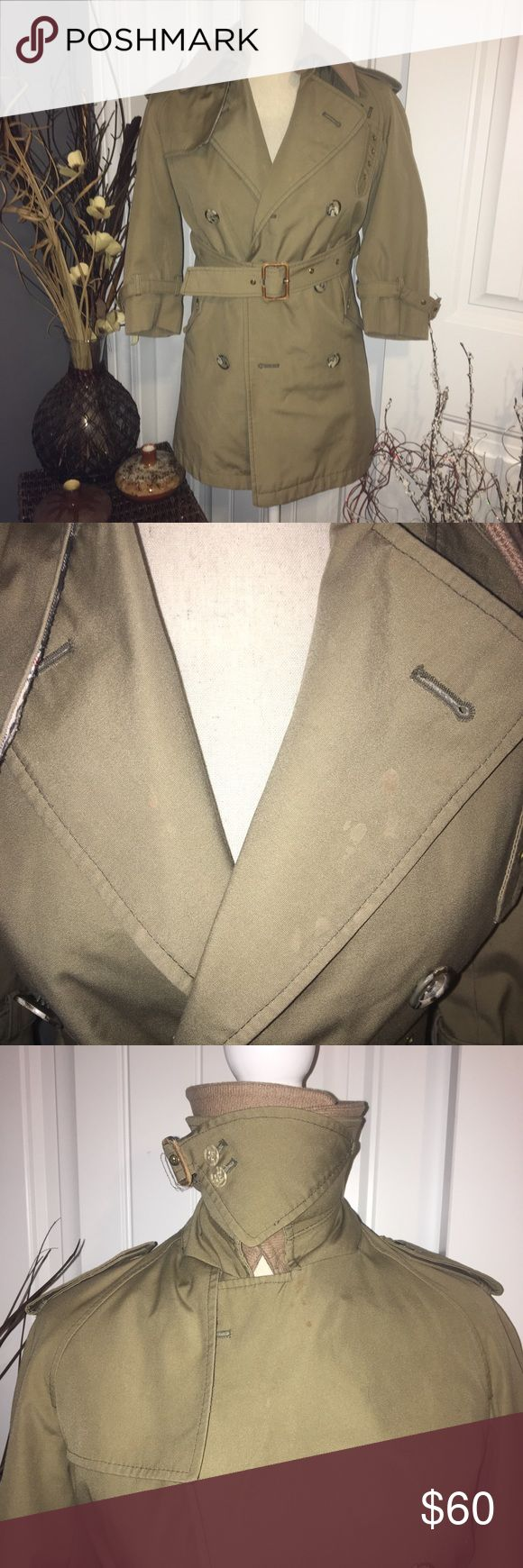 Vintage Brooks Brothers Boys Trench Coat Vintage Brooks Brothers Boys Trench Coat size 10. There are a few spots around the collar area that are likely treatable. The leather around the belt bucks has visible wear. There is a removable collar and lining inside the jacket. All buttons are intact. The quality of this jacket is very durable. Brooks Brothers Jackets & Coats