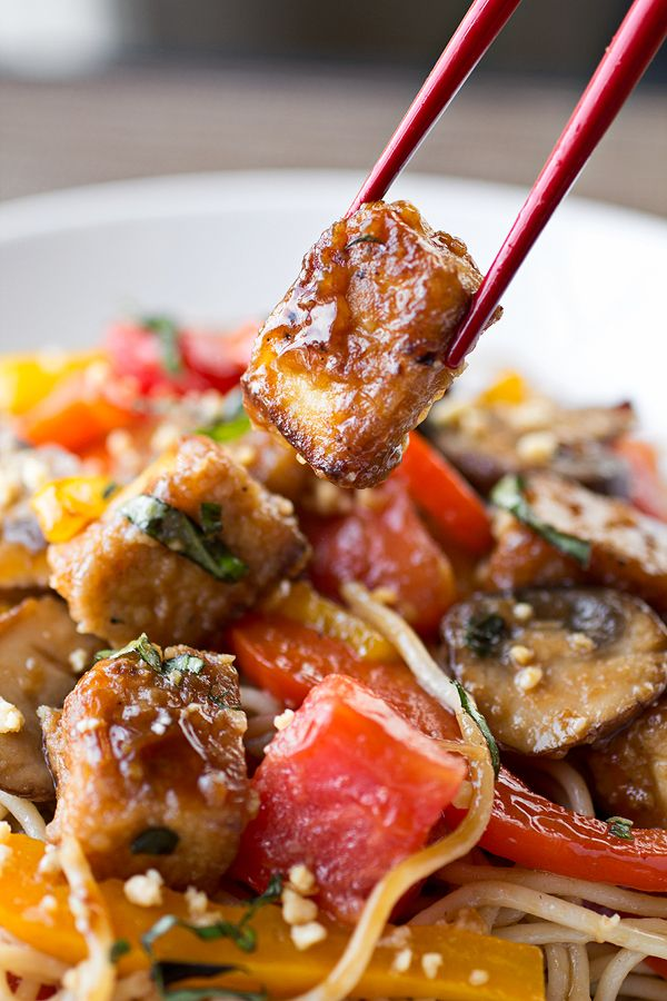 Thai-Style Crispy Tofu Sauteed with Red and Yellow Bell Peppers, Onions, Mushrooms and Tomatoes over Brown Rice Noodles - Vegan