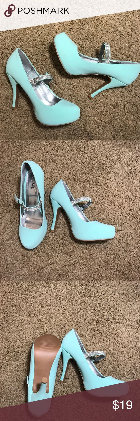 Tiffany blue heels Absolutely stunning Tiffany blue heels. Excellent condition, never been worn. Has no missing rhinestones and is a size 8. I noticed a small spot on the shoes (shown in picture). Very gorgeous pumps. Qupid Shoes Heels