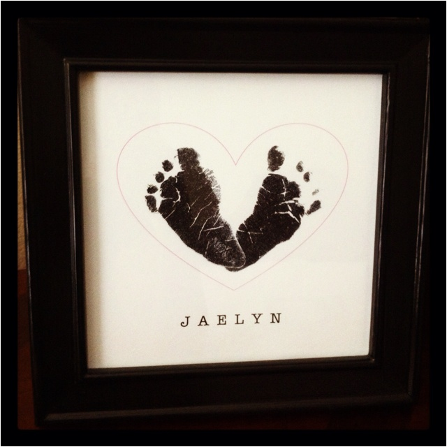 Newborn Feet -- Photocopy hospital prints, cut out, glue on page that has heart & name printed (I just used Word), then photocopy again & frame.