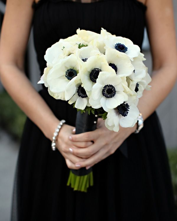 Black bridesmaids dress and anemonie wedding flowers. I actually reeeeally love this look.