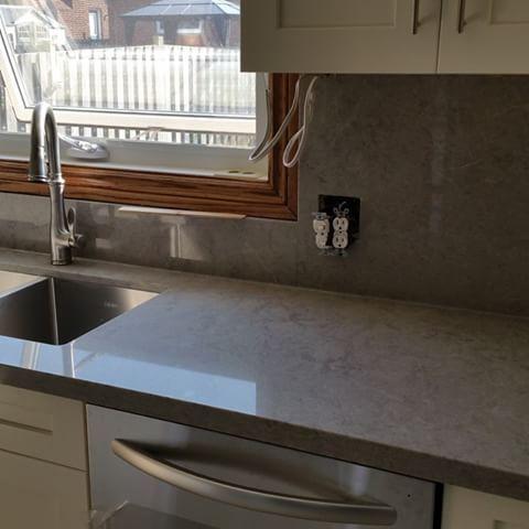 Gray Quartz Countertops With White Cabinets