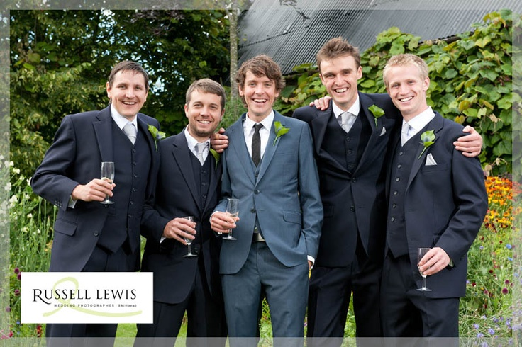 Relaxed photo of groom and ushers in smart suits near Pudleston, Leominster
