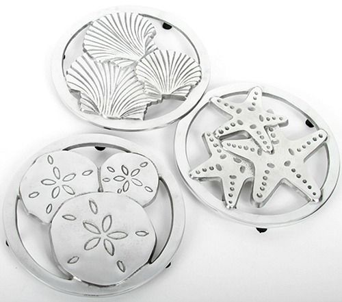 Coastal Trivets: http://www.completely-coastal.com/2016/05/coastal-nautical-kitchen-gadgets.html These coastal trivets with seashell, starfish and sand dollar designs can take the heat of an oven dish or pan... and will look awesome on the table!