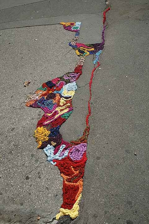 Juliana Santacruz Herrera fills the gaps and potholes of Paris with bright and colorful strands of yarn.