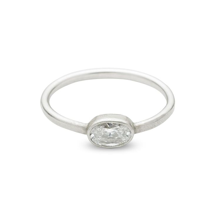 The delicate Brushed Oval by Sharon Zimmerman is perfect for the active woman. Small and airy, this light ring displays the brilliance of a foundry diamond without any prongs or raised settings. Set safely in bezel, this ring is as comfortable as it is beautiful. The brushed finish is a divine addition to the sparkle of the white gold band. Shown here as an oval cut, the diamond is available in any shape. #engagementrings