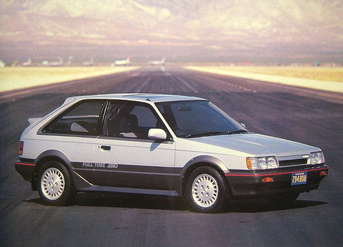 Mazda 323 4x4 Turbo. My dad had one of these in white, very rare and lots of fun.