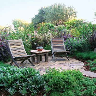 Lush slate patio    Surround a small slate patio with lush plantings for a versatile backyard retreat space. This one is 8 feet in diameter.    Get the how-to and planting plan