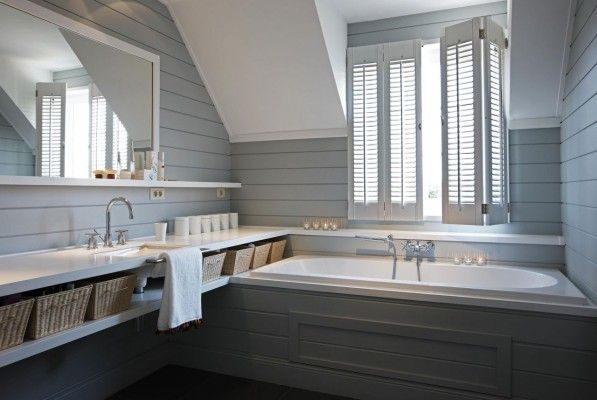 fabulous French shutter blue tongue and grove panelled bathroom in the eaves