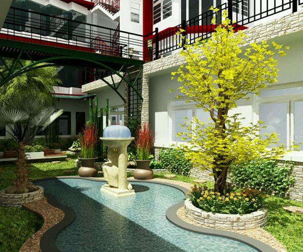 Vorgarten mit hohen Bäumen und Rasenfläche