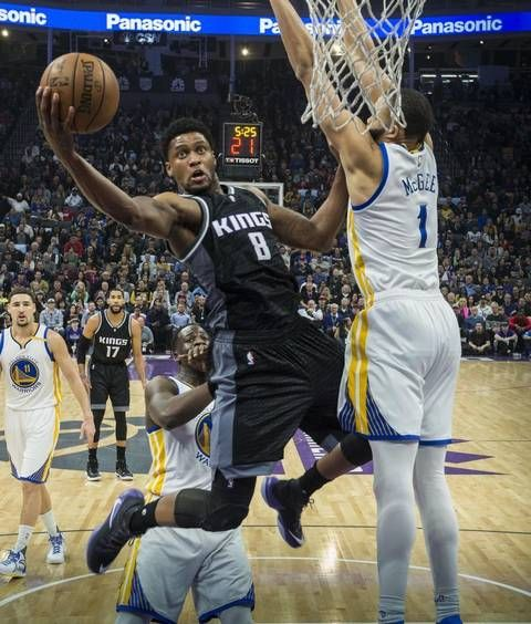Sacramento Kings forward Rudy Gay scores a basket against Golden State Warriors center JaVale McGee (1) during their game at Golden 1 Center in Sacramento, Calif., on Sunday, Jan. 8, 2017.
