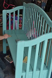 baby bed turned into bench....thinking about all the cribs we have to get rid of in Dec. due to new safety laws...