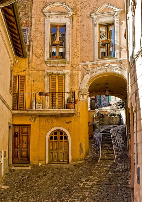 Doors, windows, and path in Rome, Italy