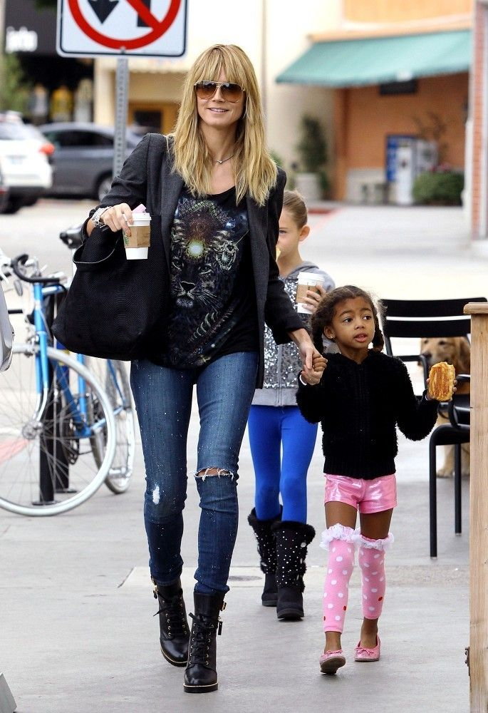 Heidi Klum rocker-chic mom style in torn denim jeans and leather jacket