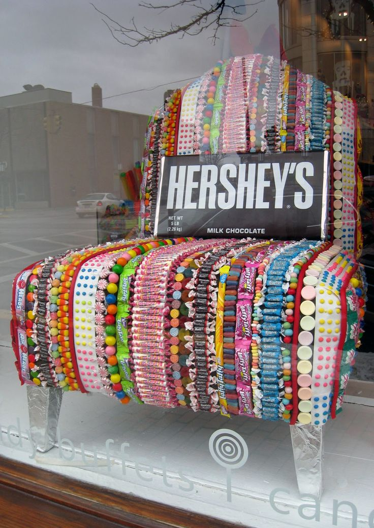 "Candy Chair display in the window of candy shop called ""Sweet Thing"" (215 N Old Woodward Birmingham, MI 48009 (248) 792-2410) in downtown Birmingham. From Anne Reeves blog."