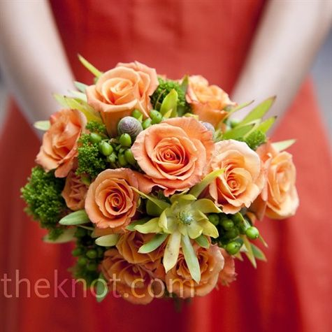 Catie's maid of honor matched her citrus-colored dress with a lush bouquet of orange roses, green berries, scabiosa pods, and green tricillium.