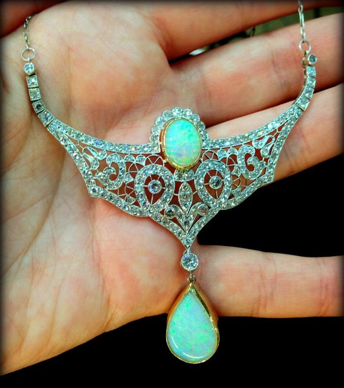 Antique opal and diamond filigree necklace in gold and platinum. Via Diamonds in the Library.