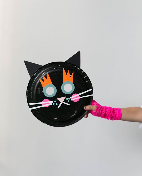 Make these frightfully festive paper plate cat and pumpkin masks with supplies you likely have sitting around! Click through for Oh Happy Day's Halloween mask tutorials.