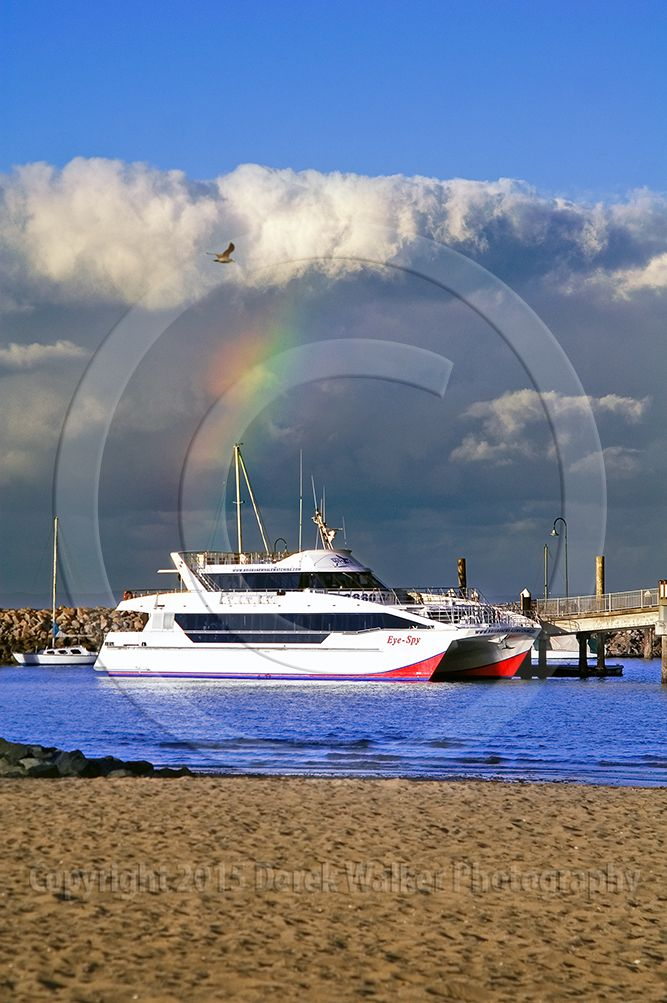 The Eye Spy of Brisbane Whale Watching at the Redcliffe jetty, with a rainbow over Moreton Bay in Queensland, Australia.  For image licensing enquiries, please feel welcome to contact me at derekwalker73@bigpond.com  Cheers :)