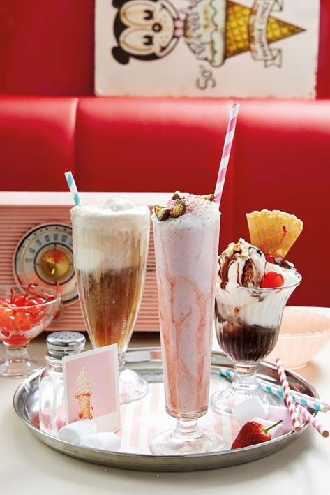 Root beer float, old fashoned strawberry soda and a hot fudge sundae, all in a 50's retro diner setting.