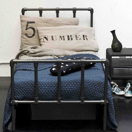 My childhood bed was a near identical version of this galvanized steel bed (minus the bedding and accessories.)