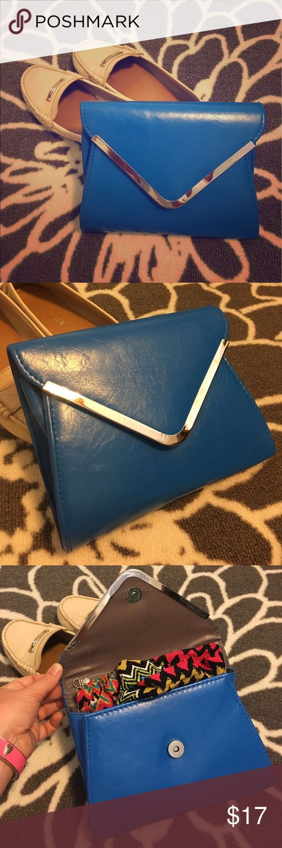 Cobalt Blue Envelope Clutch This striking blue envelope clutch easily converts to a cross body bag.  Stylish chrome detailing along the edges makes this a real standout. Bags Clutches & Wristlets