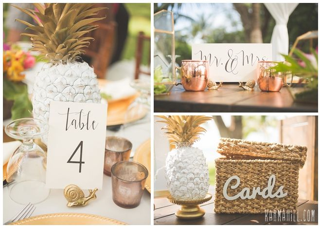 pineapple accents at a tropical themed reception table number ideas and reception decor photographed