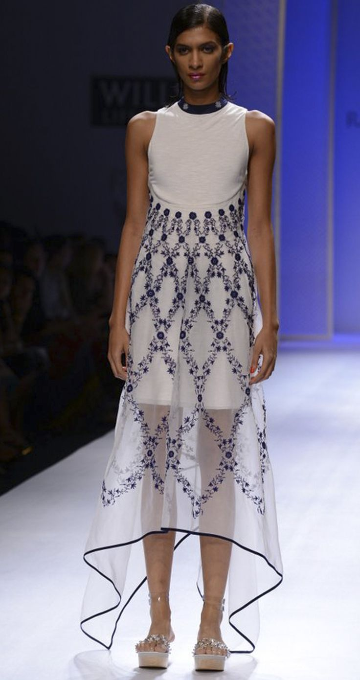 White hand embroidered long asymmetric dress by RAHUL MISHRA. http://www.perniaspopupshop.com/wills-fashion-week/rahul-mishra #fashionweek #willslifestyleindiafashionweek
