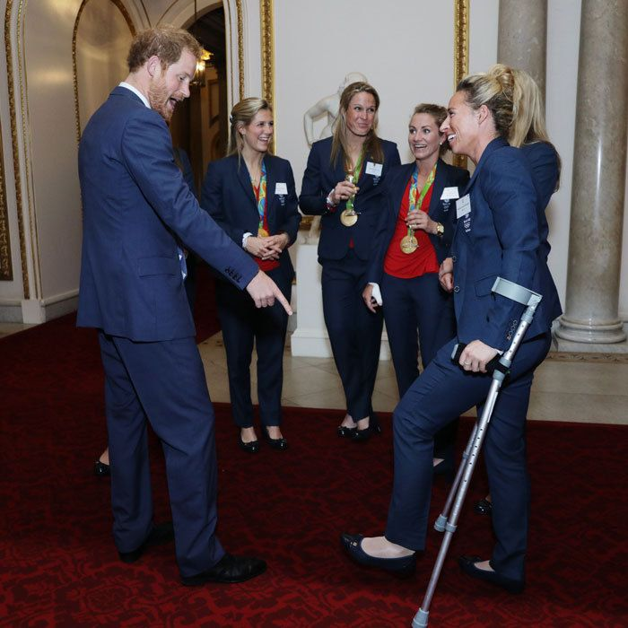 Prince Harry had some laughs with the women's field hockey team, even impersonating goalie Maddie Hinch's face when they took home the gold.