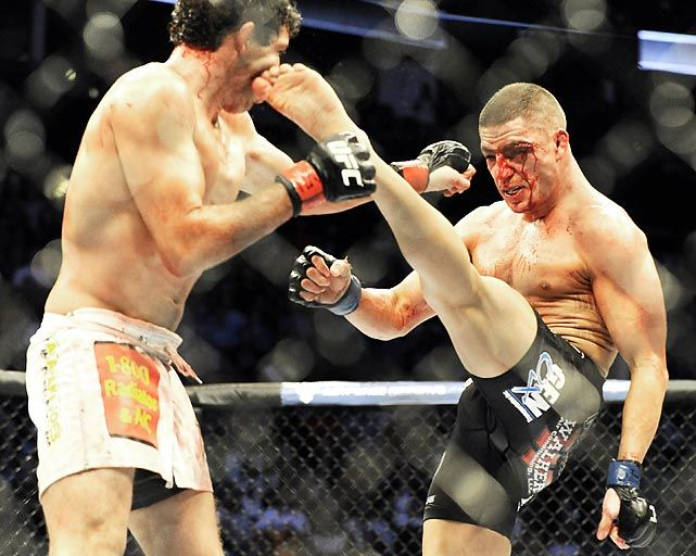 Diego Sanchez delivers a kick to Gilbert Melendez in a UFC lightweight bout. Menendez won in a unanimous decision.