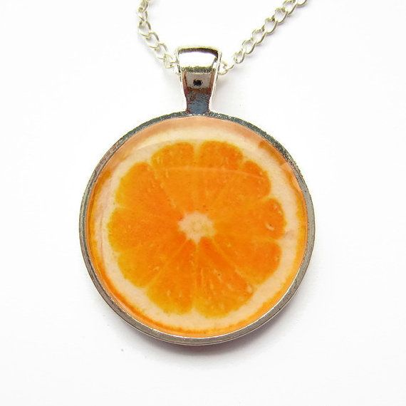 This handmade resin necklace features a fruity fresh slice of orange set under crystal resin (its not a real orange though, so dont be tempted to