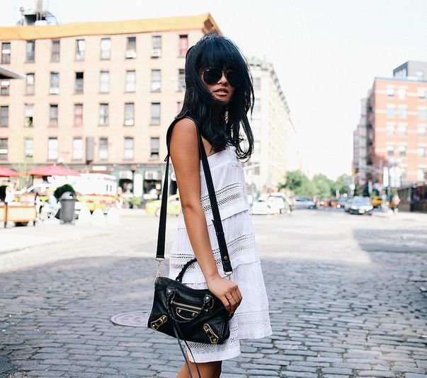 Olivia Lopez is wearing aviator sunglasses from RayBan, white crochet dress from D.ra Shanna and the classic mini bag from Balenciaga
