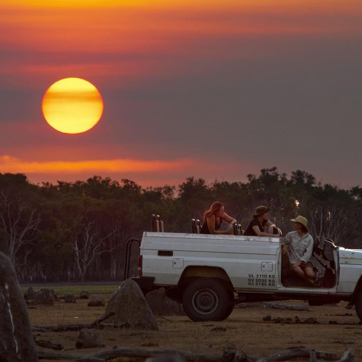 Wild Bush Luxury Guests at #BamurruPlains enjoying an afternoon 4WD Safari between the termite mounds as the sun sets over the #MaryRiver floodplain  #NTaustralia : by Peter Eve   Bamurru Plains is a bush resort for the luxury traveller