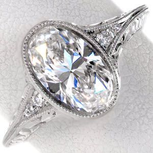 Oval Cut Engagement Rings in Hudson. Shown with oval cut diamond, hand engraving and filigree.