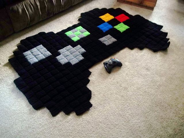 Etsy shop Harmonden sells 8-bit crochet rugs featuring characters from popular video games like Super Mario Bros., Pokémon, The Legend of Zelda, Megaman, and Minecraft. The rugs are available to pu...